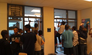The kids showing off their pull-up prowess on their donated pull up bars